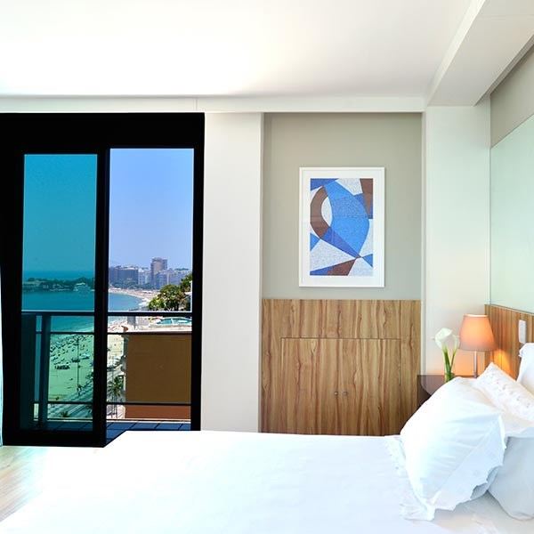 pestana-rio-atlantica-king-deluxe-suite-junior-lateral-sea-view-KDSJSV