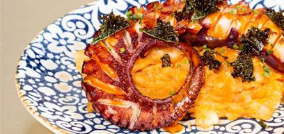Grilled octopus revolconas potatoes crispy kale